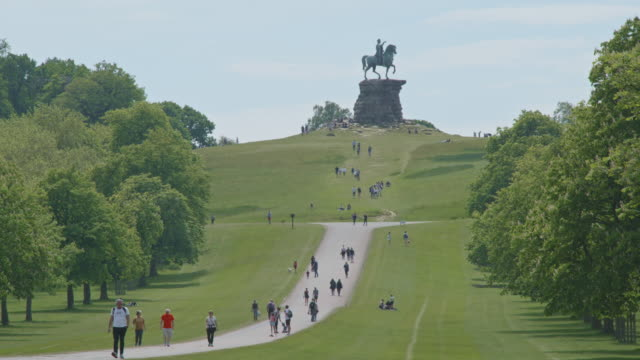 people walk and jog the path between the copper horse and windsor castle on a warm sunny afternoon in windsor great park on may 17, 2020 in... - windsor england stock videos & royalty-free footage