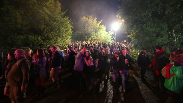 people walk around the shangri-la after hours night time area at the glastonbury festival at worthy farm, pilton on june 27, 2015 in glastonbury,... - お祭り好き点の映像素材/bロール