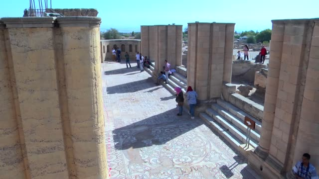 people walk at the hisham's palace archaeological site, located five kilometres north of the west bank city of jericho, on october 20 after the... - archeologia video stock e b–roll