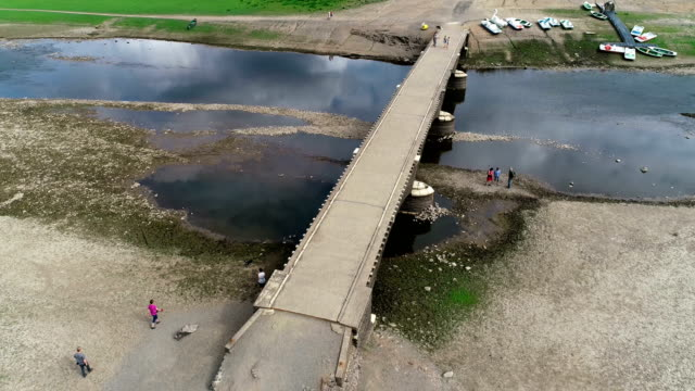 people walk at the remains of the aseler bridge which under normal circumstances would be submerged at edersee reservoir on august 21 2018 at edertal... - drought stock videos & royalty-free footage