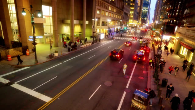 people walk by at 42nd street in new york at night. people and car traffic. busy time. city life. - abstract stock videos & royalty-free footage