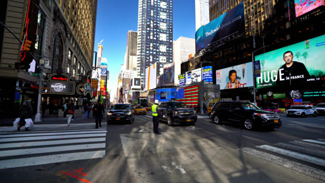 people walk by in illuminated times square in the morning. - editorial stock videos & royalty-free footage