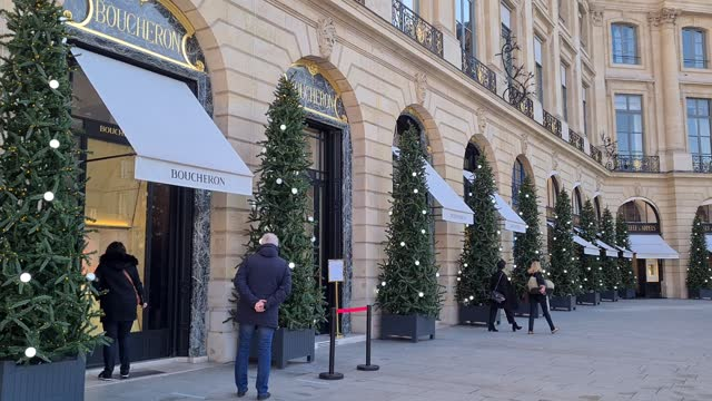 """people walk by the 'boucheron' store on place vendome on november 28, 2020 in paris, france. the reopening of stores selling """"non-essential"""" products... - place vendome stock videos & royalty-free footage"""