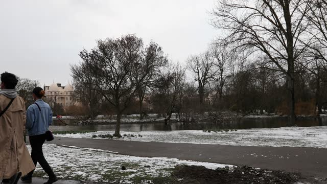 people walk by the lake in a snow covered regents park on february 9, 2021 in london, england. heavy snow brings a week of freezing temperatures... - standing water stock videos & royalty-free footage