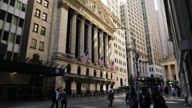 people walk by the new york stock exchange on may 30 2018 in new york city following yesterday's decline the dow jones industrial average rose over... - new york stock exchange stock videos & royalty-free footage