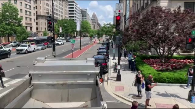 stockvideo's en b-roll-footage met people walk down 16th street after volunteers with permission from the city painted black lives matter on the street near the white house on june 05... - black lives matter
