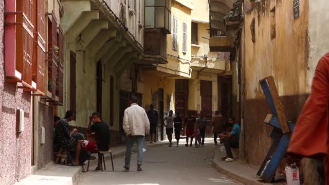 People walk down an alleyway in Casablanca