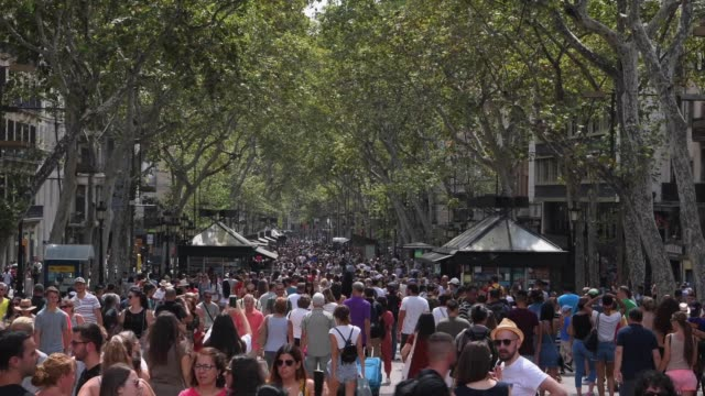 people walk down las ramblas boulevard on the first anniversary of the barcelona and cambrils terror attacks on august 17, 2018 in barcelona, spain.... - cambrils stock videos & royalty-free footage