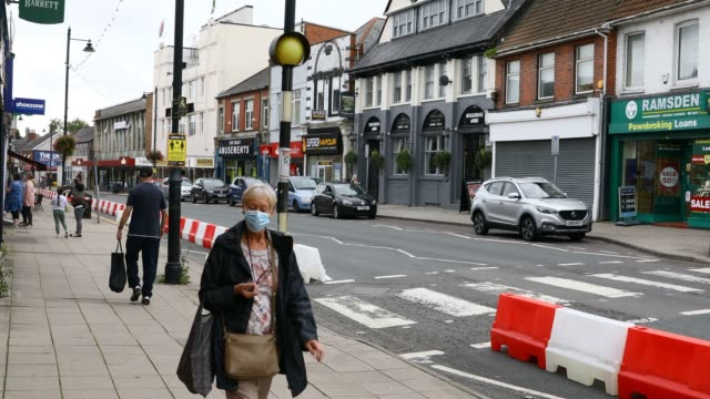 blackwood caerphilly wales september 08 people walk down the street wearing a mask as a social distancing sign is displayed in the high street near a... - reaching stock videos & royalty-free footage