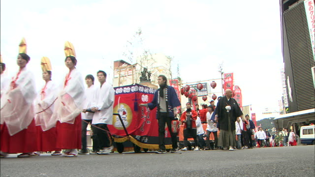 people walk in a parade. - gion stock videos and b-roll footage