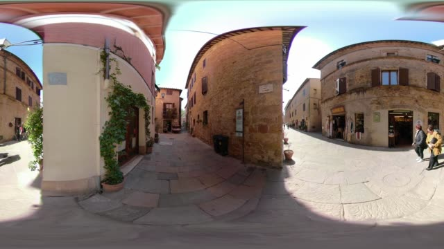 360 vr / people walk in an alley in pienza - 360 video stock videos & royalty-free footage