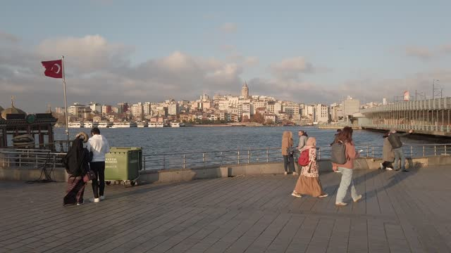 people walk in eminonu square by the golden horn during a national weekend coronavirus lockdown on december 06 in istanbul, turkey. amid surging... - weekday stock videos & royalty-free footage