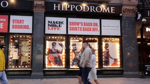 people walk in front of famous magic mike poster in hippodrome theatre at landmark leicester square as coronavirus lockdown has not been fully lifted... - landmark theatres stock videos & royalty-free footage