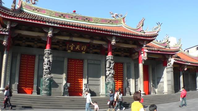 people walk in front of hsing tian kong in taipei, taiwan - taipei stock videos & royalty-free footage