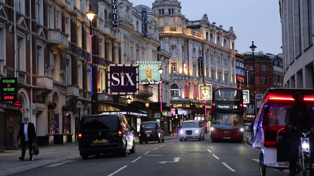 people walk in front of theatre billboards at landmark piccadilly circus as coronavirus lockdown has not been fully lifted despite previous promises... - landmark theatres stock videos & royalty-free footage