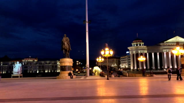 people walk in macedonia square in front of a statue of alexander the great on september 28 2018 in skopje macedonia macedonians will go to the polls... - macedonia country stock videos and b-roll footage