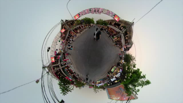 people walk in pub street at night in siem reap with little planet effect - 魚眼撮影点の映像素材/bロール