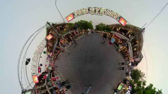 zo / people walk in pub street at night in siem reap with little planet effect - fish eye lens stock videos & royalty-free footage