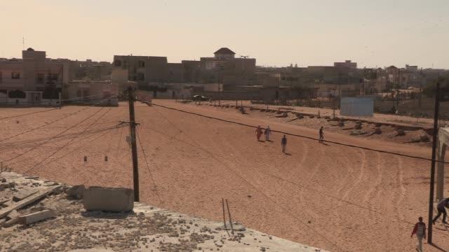 people walk in the outskirts of dakar, senegal - senegal stock videos & royalty-free footage