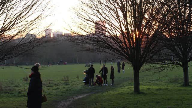people walk in the park at sunset in regent's park during the third national lockdown, of the covid-19 pandemic on january 09, 2021 in london,... - sunset stock videos & royalty-free footage