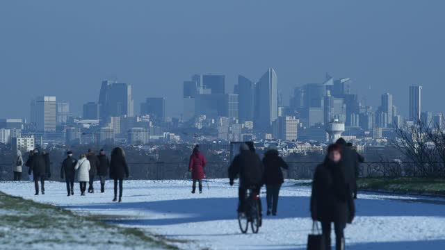 people walk in the terrasse gardens covered in snow following a light overnight snowfall on february 10, 2021 in saint germain en laye, france. the... - winter stock videos & royalty-free footage