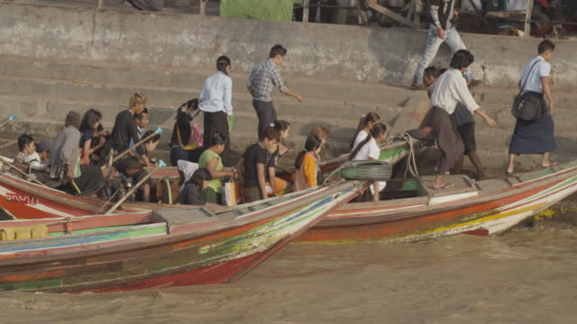 People walk off boat taxi in Myanmar