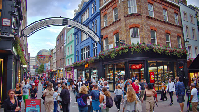 people walk on carnaby street. fashion street. - urban road stock videos & royalty-free footage