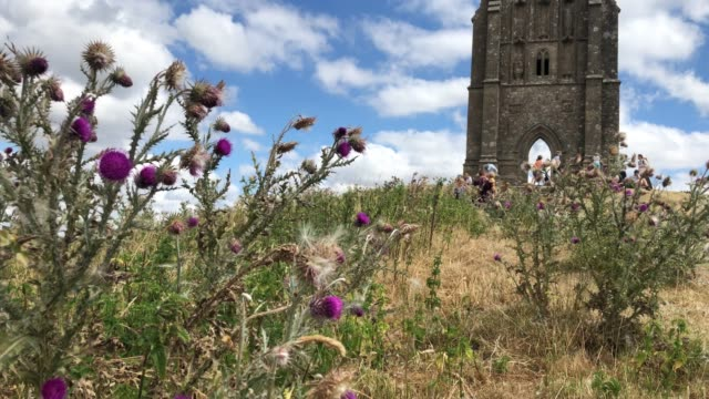 people walk on parched grass as they visit glastonbury tor in glastonbury on july 24, 2018 in somerset, england. the lack of rainfall over the last... - glastonbury tor stock videos & royalty-free footage