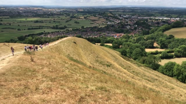 people walk on parched grass as they visit glastonbury tor in glastonbury on july 24 2018 in somerset england the lack of rainfall over the last few... - dry stock videos & royalty-free footage