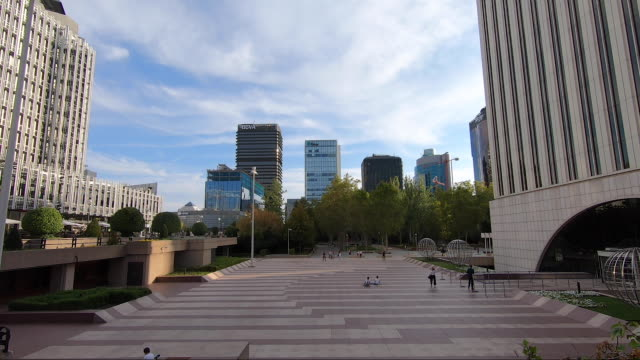 people walk on the open space in front of the iconic torre picasso in the azca complex on october 9 2020 in madrid spain azca considered the business... - leisure facilities stock videos & royalty-free footage