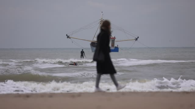 people walk on the sand of scheveningen beach near the waters of the north sea on october 19, 2020 in the hague, the netherlands. for a few days the... - silver coloured stock videos & royalty-free footage