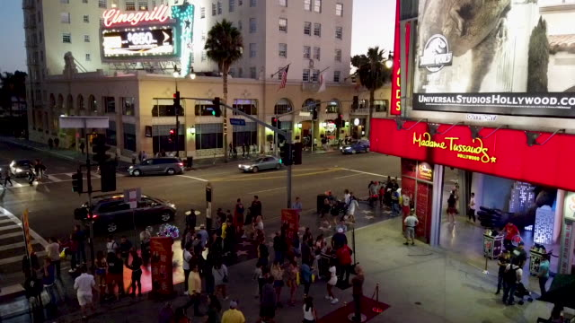 people walk outside madame tussauds hollywood along hollywood boulevard on august 18 2019 in los angeles california - madame tussauds stock videos & royalty-free footage