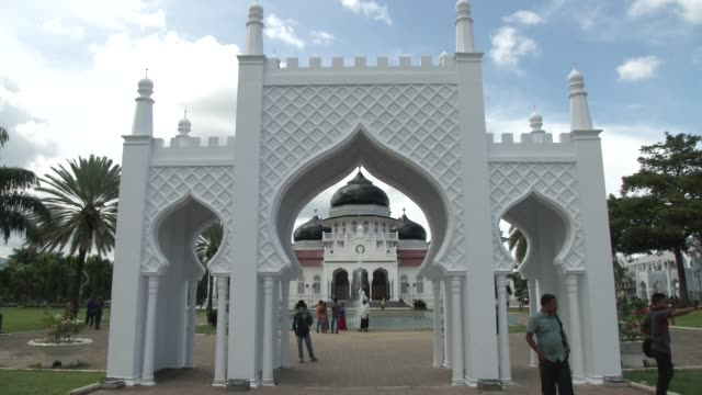 people walk outside mesjid raya baiturrahman mosque prior to the ten year anniversary of the 2004 earthquake and tsunami in banda aceh indonesia - 2014 stock videos & royalty-free footage