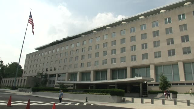 people walk outside the harry s truman building which is the headquarters of the united states department of state in washington dc the truman... - washington state stock videos and b-roll footage