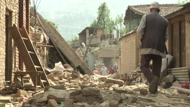 people walk over rubble in the streets of khokana / a major earthquake hit kathmandu midday on saturday april 25th and was followed by multiple... - rubble stock videos & royalty-free footage