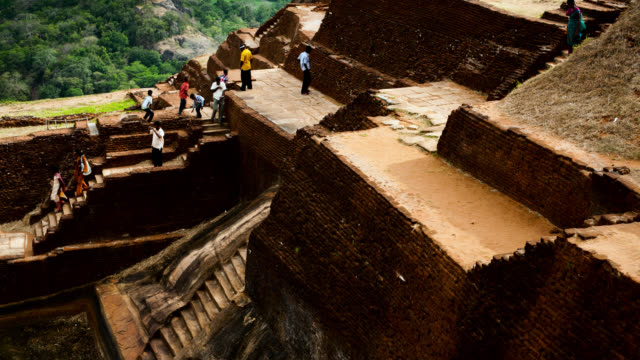 people walk over ruins of sigiriya, sri lanka. - sri lankan culture stock videos & royalty-free footage