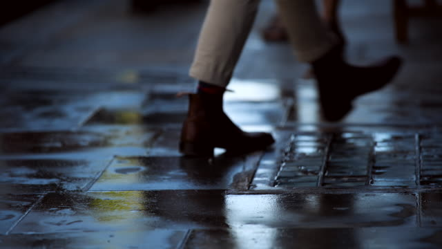 people walk over wet pavement tiles - footpath stock videos & royalty-free footage