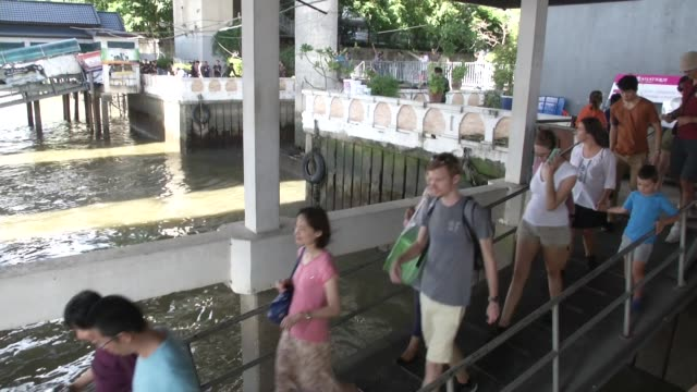 people walk past a police investigation of a bomb thrown in a canal inlet near the saphan thaksin bts and river they prepare to drain the canal to... - inlet stock videos & royalty-free footage