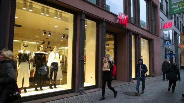 People walk past a store of Swedish clothing retailer HM on March 28 2018 in Berlin Germany HM which is the world's second largest clothing retailer...