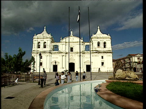 people walk past basilica cathedral of leon nicaragua - nicaragua stock videos and b-roll footage
