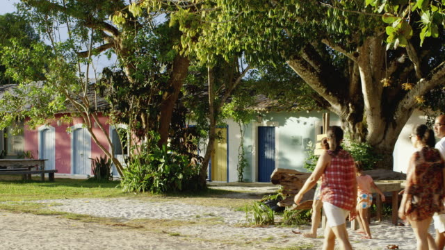 ms people walk past colonial houses in trancoso / trancoso, brazil - porto seguro stock videos & royalty-free footage