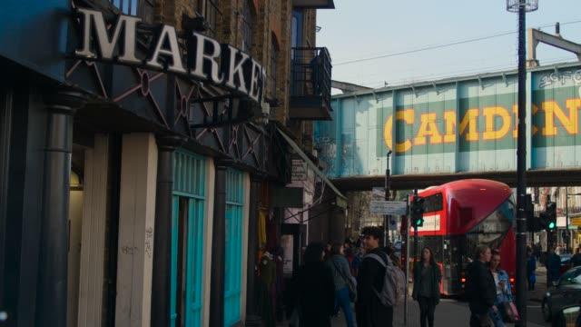 People walk past entrance to Camden Market