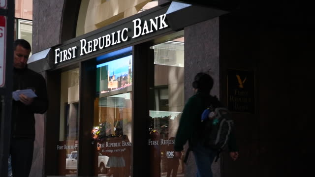 people walk past exterior of first republic bank in san francisco california on friday march 31 2017 - bankenschild stock-videos und b-roll-filmmaterial