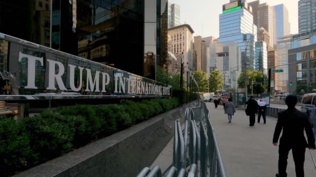 stockvideo's en b-roll-footage met people walk past metal barriers on the broadway side of trump international hotel on september 28, 2020 in new york city. - redactioneel