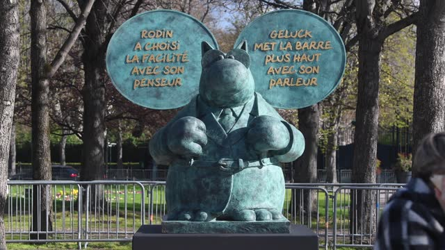 "people walk past the bronze statue of belgian cartoonist philippe geluck's character from ""le chat"" on the champs elysees avenue on march 27 in... - avenue stock videos & royalty-free footage"
