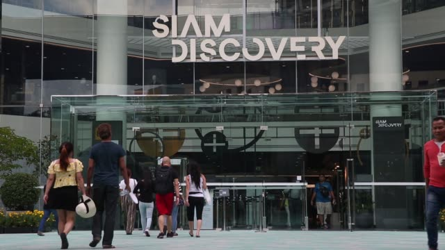 People walk past the entrance to the Siam Discovery shopping mall in Bangkok Thailand on Saturday Oct 21 People walk towards the Siam Paragon...