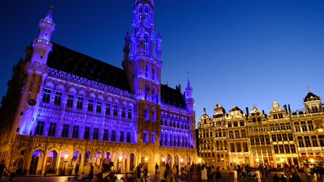 people walk past the grand place on june 13, 2021 in brussels, belgium. several local landmarks will be illuminated in nato colours to mark the nato... - blue stock videos & royalty-free footage