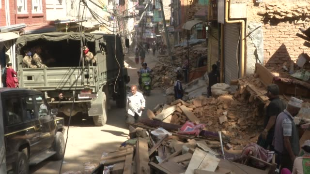People walk past the rubble of destroyed homes in Chautara / A major earthquake hit Kathmandu midday on Saturday April 25th and was followed by...
