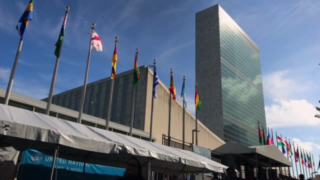 people walk past the united nations headquarters on september 26 2018 in new york city world leaders gathered for the 73rd annual meeting at the un... - united nations stock videos & royalty-free footage