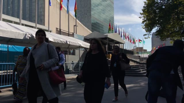 people walk past the united nations headquarters on september 26, 2018 in new york city. world leaders gathered for the 73rd annual meeting at the un... - annual general meeting stock videos & royalty-free footage